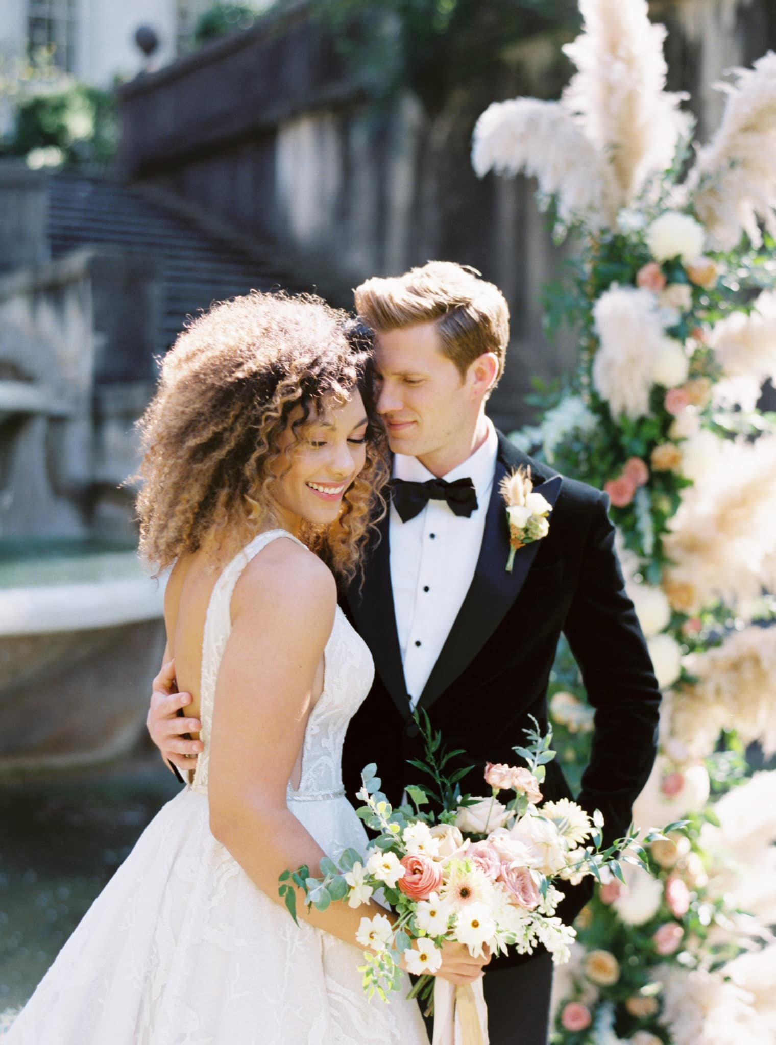 Outdoor photo of happy couple Swan House Wedding at Atlanta History Center. Flowers by The Perfect Posey. Sarah Sunstrom Photography